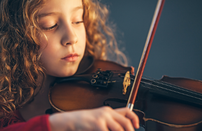 Girl taking violin lesson