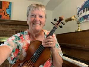 Violin instructor teaching online lesson